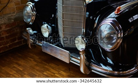 Berlin, Germany - November 15, 2015: Detail of classic car. Close-up of headlight of the museum of vintage cars - stock photo
