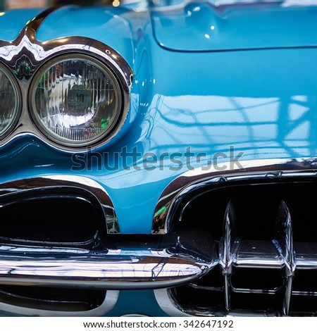 Berlin, Germany - November 15, 2015: Detail of classic car. Close-up of headlight of the museum of vintage cars