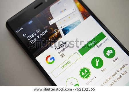 Berlin, Germany - November 19, 2017: Google application on screen of modern smartphone in Play Store