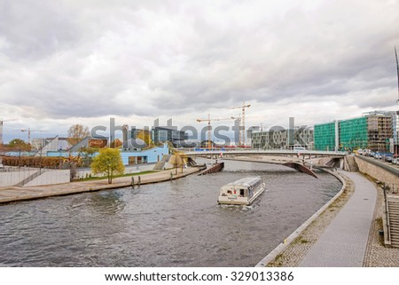 Berlin, Germany - October 28, 2013: Passenger sightseeing ship on the Spree river - view towards the main train station from government district.