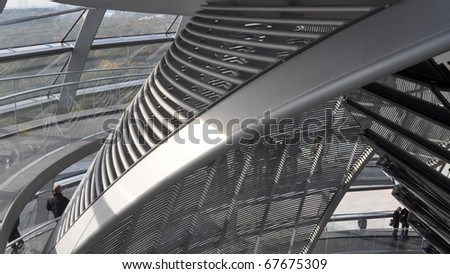 BERLIN, GERMANY - OCTOBER 23: People visiting the Reichstag dome at the German parliament October 23, 2010 in Berlin, Germany - stock photo