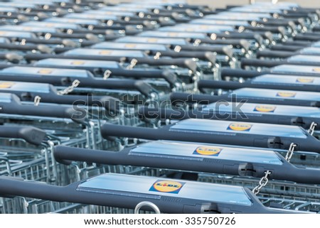 "Berlin, Germany - October 29, 2015:  Shopping Carts with the brand ""LIDL"" at a supermarket building on October 29, 2015 in Berlin, Germany, Europe,"