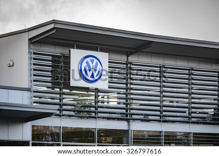 "BERLIN, GERMANY - OCTOBER 5: the VW logo of the brand ""Volkswagen"" at a car dealer building on Oct 5, 2015 in Berlin, Germany, Europe. Volkswagen AG is a German automotive manufacturing company."