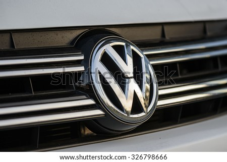 "BERLIN, GERMANY - OCTOBER 5: the VW logo of the brand ""Volkswagen"" at a car  on Oct 5, 2015 in Berlin, Germany, Europe. Volkswagen AG is a German automotive manufacturing company. - stock photo"