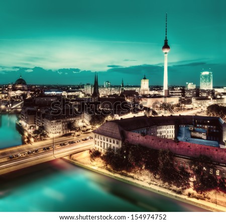 Berlin, Germany rooftop view on Television Tower, Berlin Cathedral, Rotes Rathau and the River Spree - the major landmarks at night - stock photo