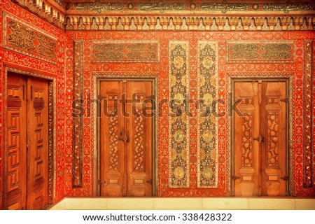 BERLIN, GERMANY - SEPT 2, 2015: Calligraphy and paintings on the doors of 17th century Aleppo room, Syrian house on Septemper 2, 2015. Artifacts obtained in 1912 by Pergamon Museum in Berlin - stock photo