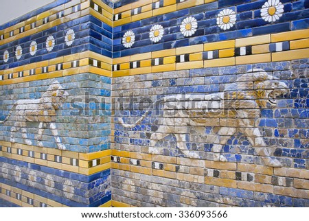 BERLIN, GERMANY - SEPT 2, 2015: Lions following on the hunt, patterned wall of cityBabylon, constructed in 575 BC. on Septemper 2, 2015. Artifact of Iraq saved by Pergamon Museum in Berlin