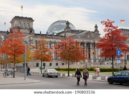 BERLIN, GERMANY - SEPT 23,2012:Tourists near Reichsta. After moving of Bundestag to Berlin in 1999 building of Reichstag was visited by over 13 mil. from all over world
