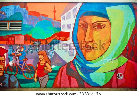 BERLIN, GERMANY - SEPT 1, 2015: Urban graffiti with face of woman in hijab living in area of immigrants on Septemper 1, 2015. Urban area of Berlin comprised 4 million people, 7th most populous in EU - stock photo