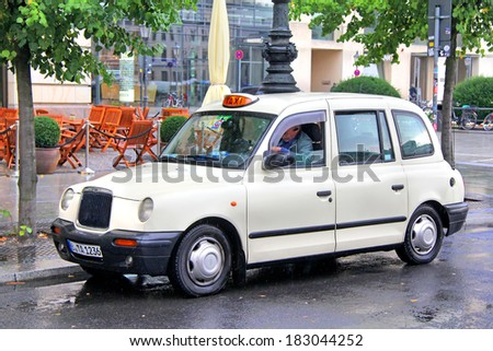 BERLIN, GERMANY - SEPTEMBER 11, 2013: Classic British cab LTI TX1 at the city street. - stock photo
