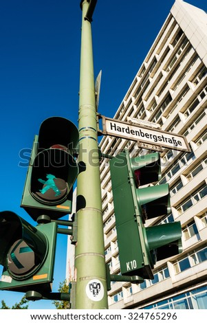 BERLIN, GERMANY - SEPTEMBER 28, 2015: Hardenbergstreet, a typical Eastern German crossroads with the typical Eastern pedestrian traffic lights - Ampelmaennchen, the green walking man - stock photo