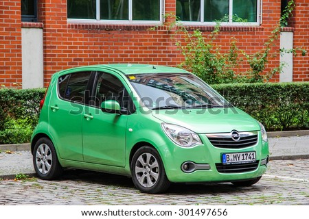 BERLIN, GERMANY - SEPTEMBER 12, 2013: Motor car Opel Agila at the city street. - stock photo