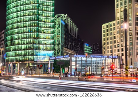 BERLIN, GERMANY - SEPTEMBER 21:  Potsdamer platz on September 21, 2013 in Berlin. Front view of Potsdamer platz station at night, with skyscrapers and people around