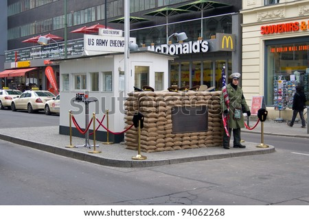 BERLIN - JANUARY 27: Checkpoint Charlie, on January 27, 2011 in Berlin, Germany. Checkpoint Charlie famous passage between the West and East Berlin during the Cold War. - stock photo