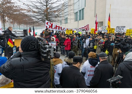 BERLIN - JANUARY 23, 2016: Russian diaspora in Berlin protested against migrants and refugees due to the violence of women and children. - stock photo