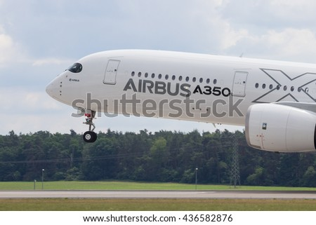 BERLIN - JUN 2, 2016: Airbus A350 XWB landing after it's aerial display at the Berlin Airshow ILA on Berlin-Schoneveld airport - stock photo