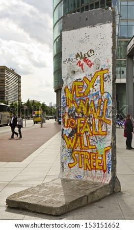 BERLIN - JUNE 13: a section of the Berlin wall at Potsdamer Platz one June 13, 2013 in Berlin, Germany. The Berlin Wall divided East Germany and West Germany for 28 years, between 1961 and 1989.