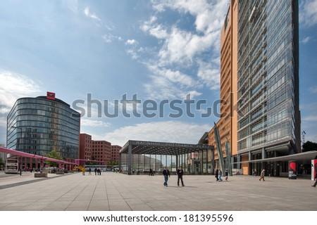 BERLIN - JUNE 3, 2013: People walking in Potsdamer Platz. The Potsdamer Platz is the new modern city center of Berlin.  - stock photo