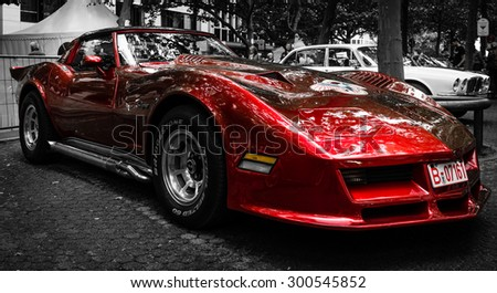 BERLIN - JUNE 14, 2015: Sports car Chevrolet Corvette C3 Stingray coupe. Stylization. Toning. The Classic Days on Kurfuerstendamm. - stock photo