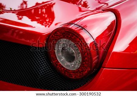 BERLIN - JUNE 14, 2015: Stoplight of a sports car Ferrari 458 Spider (since 2011). The Classic Days on Kurfuerstendamm. - stock photo