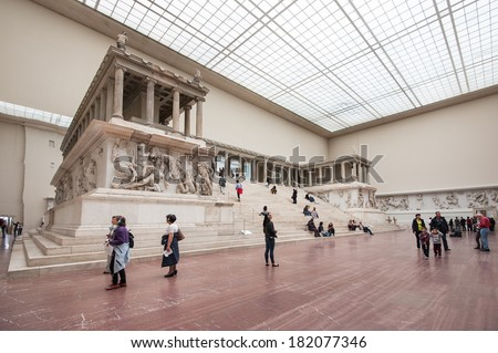 BERLIN - JUNE 3, 2013: Tourists inside the Hall of Pergamon museum, the most visited in Berlin. It hosts more than 1.5 million visitors per year. - stock photo