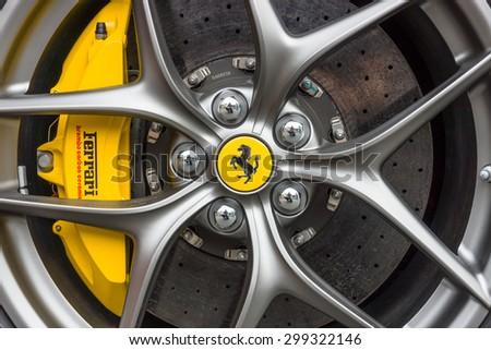BERLIN - JUNE 14, 2015: Wheel and brake system of sports car Ferrari F12berlinetta. The Classic Days on Kurfuerstendamm. - stock photo