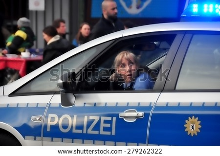 BERLIN - March 3: Policewoman waiting for the helicopter to land during knifing accident on March 3, 2015 in Berlin, Germany. - stock photo