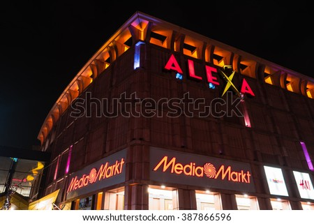 BERLIN - MARCH 05, 2016: Shopping center Alexa on Alexanderplatz in the evening illumination. Alexa is the second largest (56.200 square meters) shopping center in Berlin. - stock photo