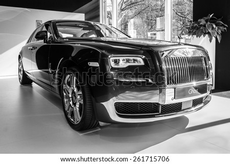 BERLIN - MARCH 08, 2015: Showroom. Full-size luxury car Rolls-Royce Ghost. Black and white. Rolls-Royce Motor Cars Limited global manufacturer of luxury cars. - stock photo