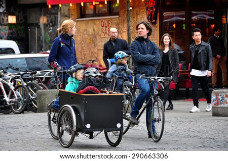 BERLIN MARCH 6: Unidentified Berliners on the bicycles (over 15% people in Berlin prefer moving by bike) on March 6, 2015. - stock photo