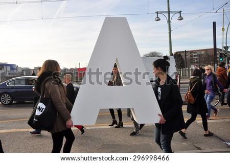 BERLIN MARCH 5: Unidentified females bear the letter in Berlin on March 5, 2015. - stock photo