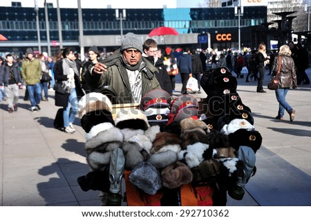BERLIN MARCH 5: Unidentified pitchman on Alexanderplatz (very popular place among citizens and tourists) on March 5, 2015. - stock photo