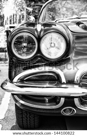 BERLIN - MAY 11: Detail of the front of the sports car Chevrolet Corvette (C1), black and white, 26th Oldtimer-Tage Berlin-Brandenburg, May 11, 2013 Berlin, Germany - stock photo