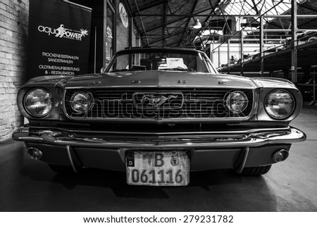 BERLIN - MAY 10, 2015: Pony car Ford Mustang (first generation). Black and white. 28th Berlin-Brandenburg Oldtimer Day - stock photo