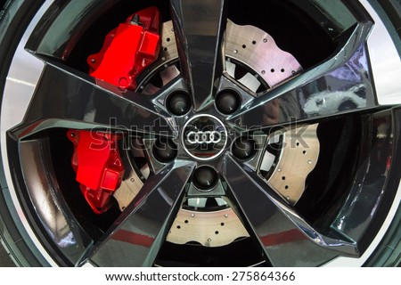 BERLIN - MAY 02, 2015: Showroom. Wheels and braking system components of a hot hatch Audi RS3 (8VA). Produced since 2015.