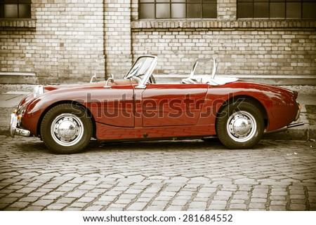BERLIN - MAY 10, 2015: Sports car Austin-Healey Sprite Mk I. Stylization. Vintage toning. Side view. 28th Berlin-Brandenburg Oldtimer Day - stock photo