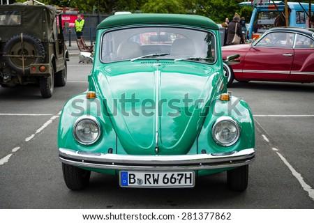 BERLIN - MAY 10, 2015: Subcompact, economy car Volkswagen Beetle. 28th Berlin-Brandenburg Oldtimer Day - stock photo