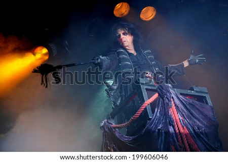 BERLIN - NOVEMBER 14: Legendary American rocker Alice Cooper during his performance in Berlin, Germany, November 14, 2011. - stock photo