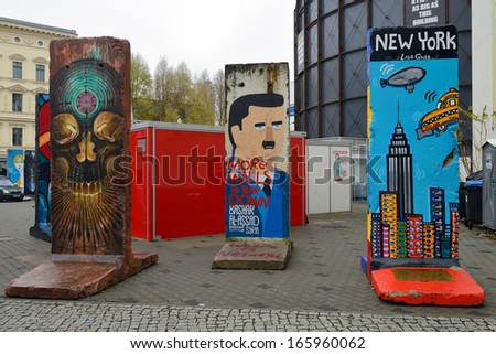 BERLIN - NOVEMBER 23: Part of the Berlin Wall with a graffiti near Museum Haus am Checkpoint Charlie on November 23, 2013 in Berlin, Germany. - stock photo