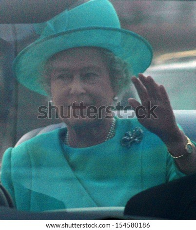 BERLIN-NOVEMBER 2, 2004: Queen Elizabeth II (Elizabeth Alexandra Mary Windsor) in her car during a state visit in Germany. - stock photo