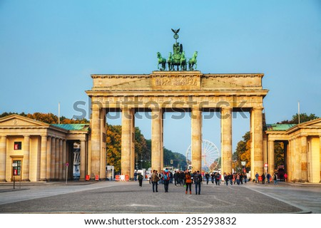 BERLIN - OCTOBER 3: Brandenburg gate (Brandenburger Tor) on October 3, 2014 in Berlin, Germany. It's an 18th-century neoclassical triumphal arch in Berlin, one of the best-known landmarks of Germany. - stock photo