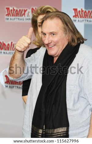BERLIN - OCTOBER 01: Catherine Deneuve and Gerard Depardieu attend the 'Asterix & Obelix God Save Britannia' photocall at Hotel de Rome on October 1, 2012 in Berlin, Germany. - stock photo