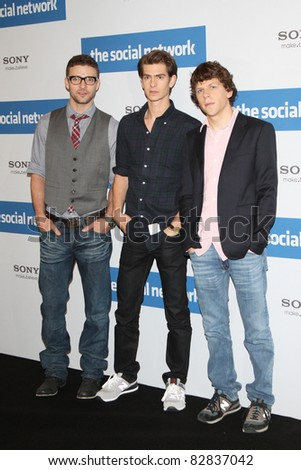 BERLIN - OCTOBER 05: Justin Timberlake, Andrew Garfield and Jesse Eisenberg attend a photocall to promote the film 'The Social Network' at Hotel Adlon on October 5, 2010 in Berlin, Germany - stock photo