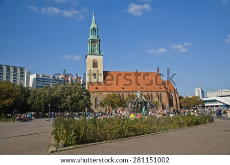 BERLIN,OKTOBER 02:2014 Tourist visit St. Mary Church, known in German as the Marienkirche, located in central Berlin, near Alexanderplatz in Oktober,2014