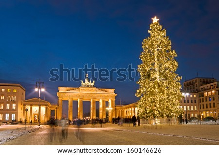 berlin pariser platz and brandenburg gate in winter with christmas tree - stock photo