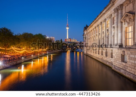 Berlin's River Spree, TV Tower, and side of the Bode Museum at dusk - stock photo