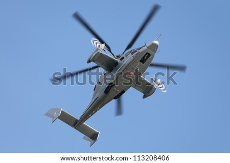 BERLIN - SEP 11: Eurocopter X3 helicopter shown at ILA Berlin Air Show 2012 on September 11, 2012, Berlin, Germany.