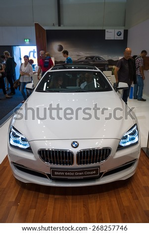 BERLIN - SEPTEMBER 09, 2012: Showroom. Grand tourer / executive coupe BMW 640i Gran Coupe (F06). Produced since 2012. - stock photo