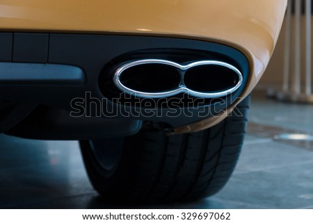 BERLIN - SEPTEMBER 04, 2012: Showroom. The exhaust system of a personal luxury car Bentley New Continental GT V8. Close-up. Produced since 2013. - stock photo