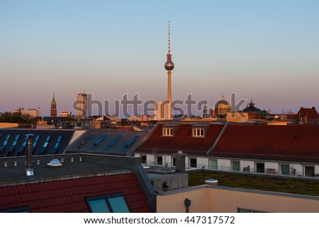 Berlin skyline with Fernsehturm (TV Tower), Neue Synagogue, and townhomes - stock photo